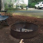 Campfire ring with rental trailer in the background