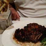 Porcine rubbed bone-in ribeye with truffle fries