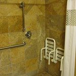 Bench seats in roll-in shower.