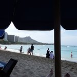 View of the water and Diamondhead from beach umbrella at hotel