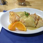 This was their special for breakfast:  Two crepes stuffed with eggs, ham, onion and cheese, topp
