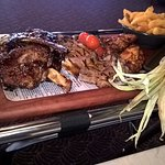 The share plate with steakhouse fries, corn, BBQ chipotle sauce & bacon jam