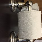 As you can see, one side of this toilet paper holder I cleaned