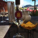 The Marchesi logo wine glass on the patio with the view in the distance