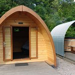 Pod with decking, hot tub under cover and dining table