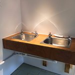 Sinks in the ladies' loos. Would benefit from some soap, a hook or two, and more frequent cleani