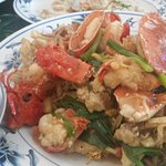 Lobster and crab with scallion and ginger over crispy noodles