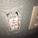 No cover on the electrical outlet. Fire Marshal should pay this place a visit.