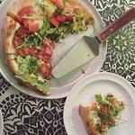 parma pizza - prosciutto, reggiano, fresh mozzarella, arugula, and roma tomatoes