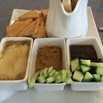 Artichoke Dip, Roasted Red Pepper Hummus & Mediterranean Black Olive Tapenade served with a vari
