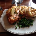 Battered cod, chips & peas.