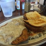 Country-fried steak with white gravy, over-easy eggs and hash browns. DELICIOUS!