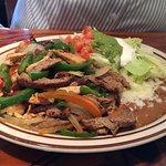 Fajitas (chicken, steak, bell peppers, onions, beans, lettuce, sour cream, guac)