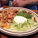 Arroz con Mariscos (grilled shrimp & scallops over rice, lettuce, guac, sour cream)