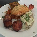 The Surf and Surf dinner entree. Lobster thermidor and bacon wrapped scallops.