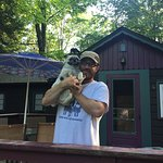 My husband and pup standing on the porch of cottage #4