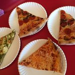 Pizza by the slice, Mushroom pepperoni, Pesto cheese and cheese pizzas