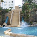 Outdoor pool with water slides.
