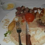 Steak so tough and tasted dreadful swimming in a tasteless sauce