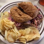 pulled pork sandwich with chipotle slaw piled high