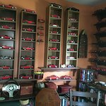 Inside his office. He collects model cars that he paints red!