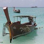 A longtail boat on Sunrise Beach