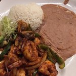 One for the road (name of the drink). The entree is Spicy Shrimp Saltado.