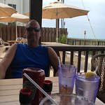 Relaxing with a beverage at the Cafe on the Beach at the Palms Resort
