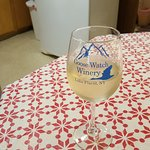 In my motel room - Goose Watch wine and souvenir tasting glass