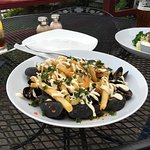 Mussels topped with fries and aioli