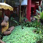The lush front yard of the hotel. This is a statue of the great King Jayavarman VII.