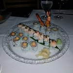 Delicious scallop appetizer and fresh sushi rolls