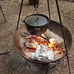 Cooking pot roast pork and potatoes on the camp fire with equipment provided by the owners.