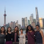 Jenny with customers in front of Shanghai skyline
