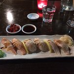 Grilled sushi of salmon, kingfish and scallop