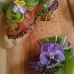 Vegetarian open sandwich. Avocado, Tomato and a pesto salad