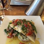 Baked fillet of sea bass, crushed new potatoes with with Niçoise salad and sauce vierge