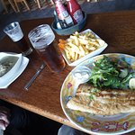 Curry, broiled hake, chips and some local ale