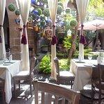 Outdoor restaurant/cafe in hotel courtyard