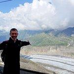 Standing atop the mountain overlooking the Aletsch Glacier, Fiesch, Switzerland.