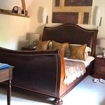 Picture shows a small portion of the bedroom which is ensuite. Lovely decor, sleigh bed.