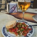 All of the cafes nearby serve tapas with a drink ($2.25)