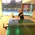 ping pong table outside the indoor pool area