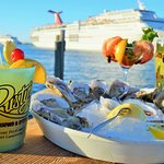 Fresh oysters and cold drinks on our outdoor deck as the cruise ships steam by...