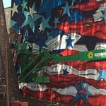 Famous street artist Annie Preece painting our American flag