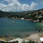 View of Bay in Shtikovica. The man on the digger was cracking rocks for the beach.