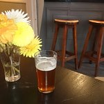 Cask beer and summer flowers