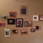 Pictures frames on my wall in the room.