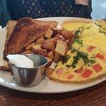 Toast, breakfast potatoes, and veggie omelette