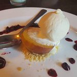 Baked Peach with berry compote and vanilla ice cream